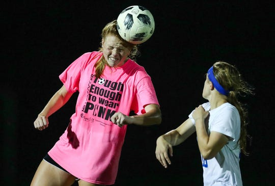 Noblesville's Sydney Anderson (14) heads the ball after a goal kick by Carmel at White River Elementary School soccer complex on Monday, Sept. 17, 2018.
