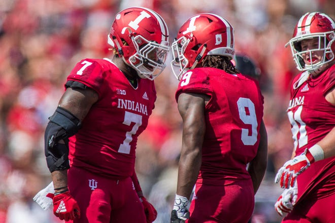 Hoosiers defensive back Jonathan Crawford (9) celebrates his sack with linebacker Reakwon Jones (7) in the second half against the Ball State Cardinals at Memorial Stadium.