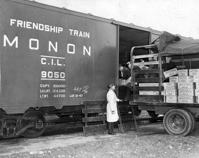 Evaporated milk, donated by the American Legion is loaded onto a boxcar in Indianapolis to became part of the Friendship Train in Chicago in 1947.