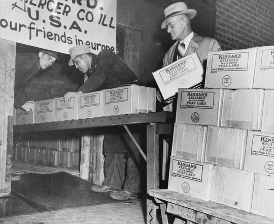 Cases of lard donated by Kingan and Company are loaded into a boxcar in Indianapolis on Nov. 12, 1947 and will be added to the Friendship train in Chicago. The train, rolled through the United States collecting food and supplies for a war-torn France.