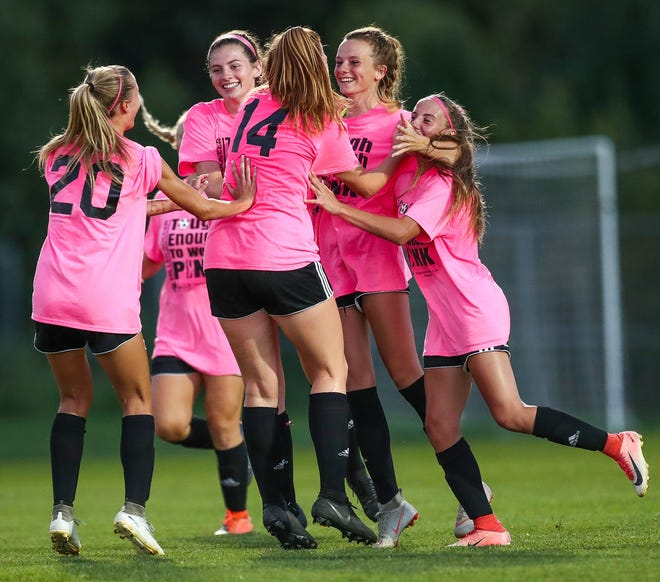 The Noblesville Millers celebrate a goal by Noblesville's Carly Hudnall (6) against the Carmel Greyhounds at White River Elementary School soccer complex on Monday, Sept. 17, 2018.