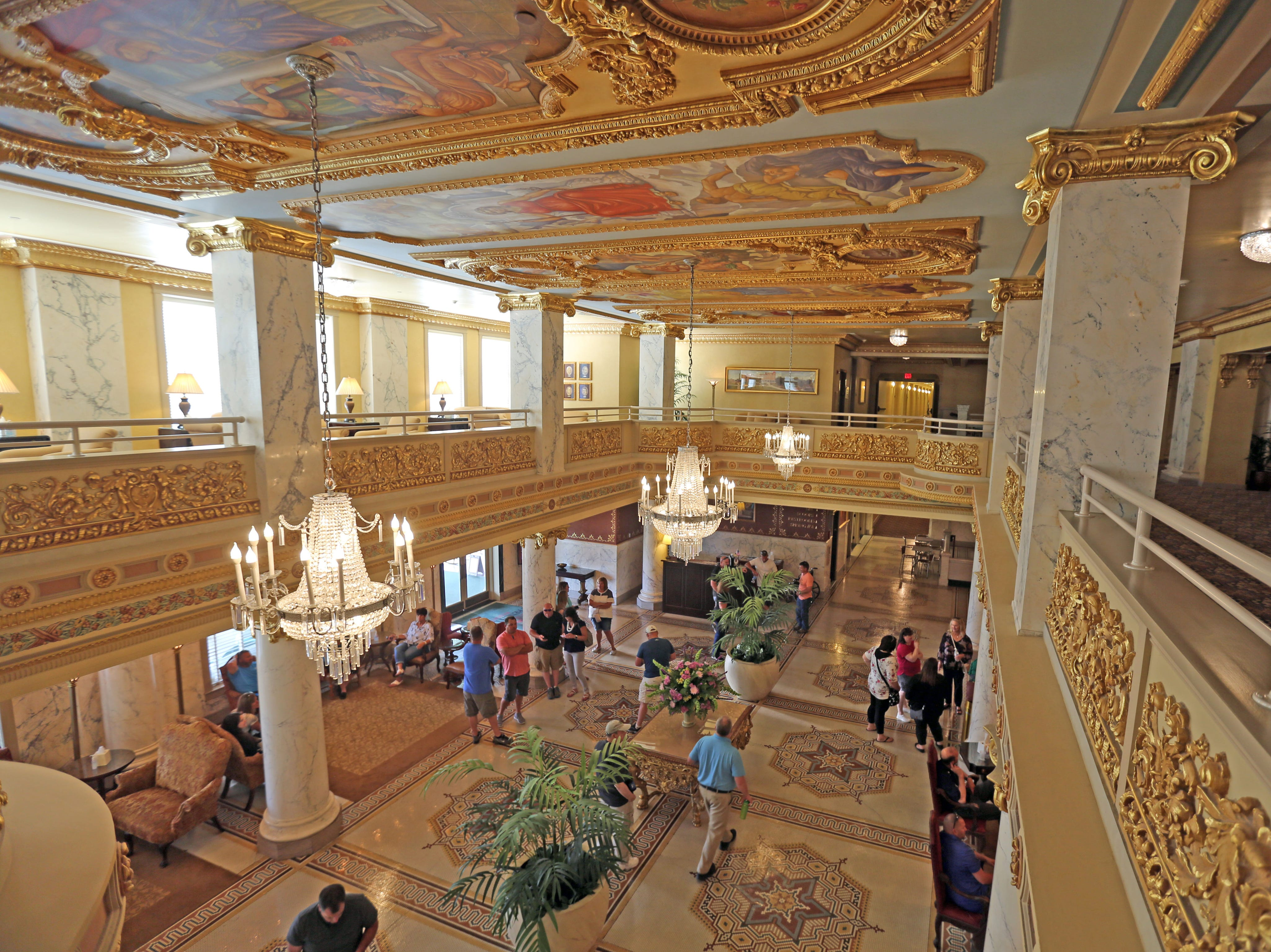 The ornate lobby of the French Lick Hotel glows from the gold-leaf embellishments in July 2018.