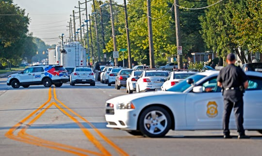 Police and emergency vehicles block the street in the 3200-3400 block of N. Keystone Ave., during a police SWAT incident after a home invasion that became an abduction, from a home on Schofield Ave. earlier in the day.