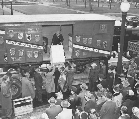 Small seedling trees, carefully packed in French soil and straw, were in the first box unloaded from the 40 & 8 car of the Merci Train at the Indiana World War Memorial on Feb. 13, 1949.