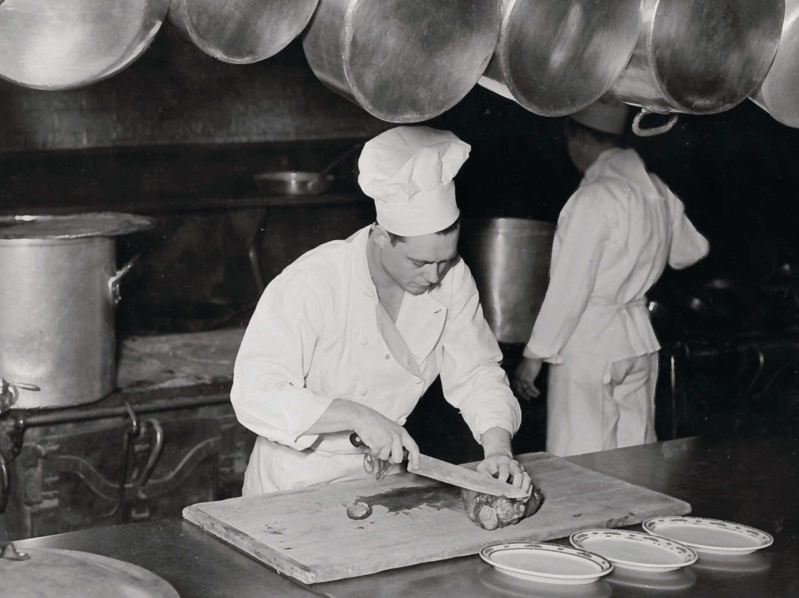 Chefs prepare meals in the kitchen at the French Lick Springs Hotel.
