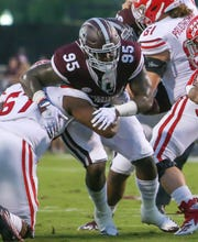 Mississippi State's Braxton Hoyett (95) fights off  a block by Louisiana's Ken Marks (67). Mississippi State and Louisiana played in a college football game on Saturday, September 15, 2018, in Starkville. Photo by Keith Warren/Madatory Photo Credit