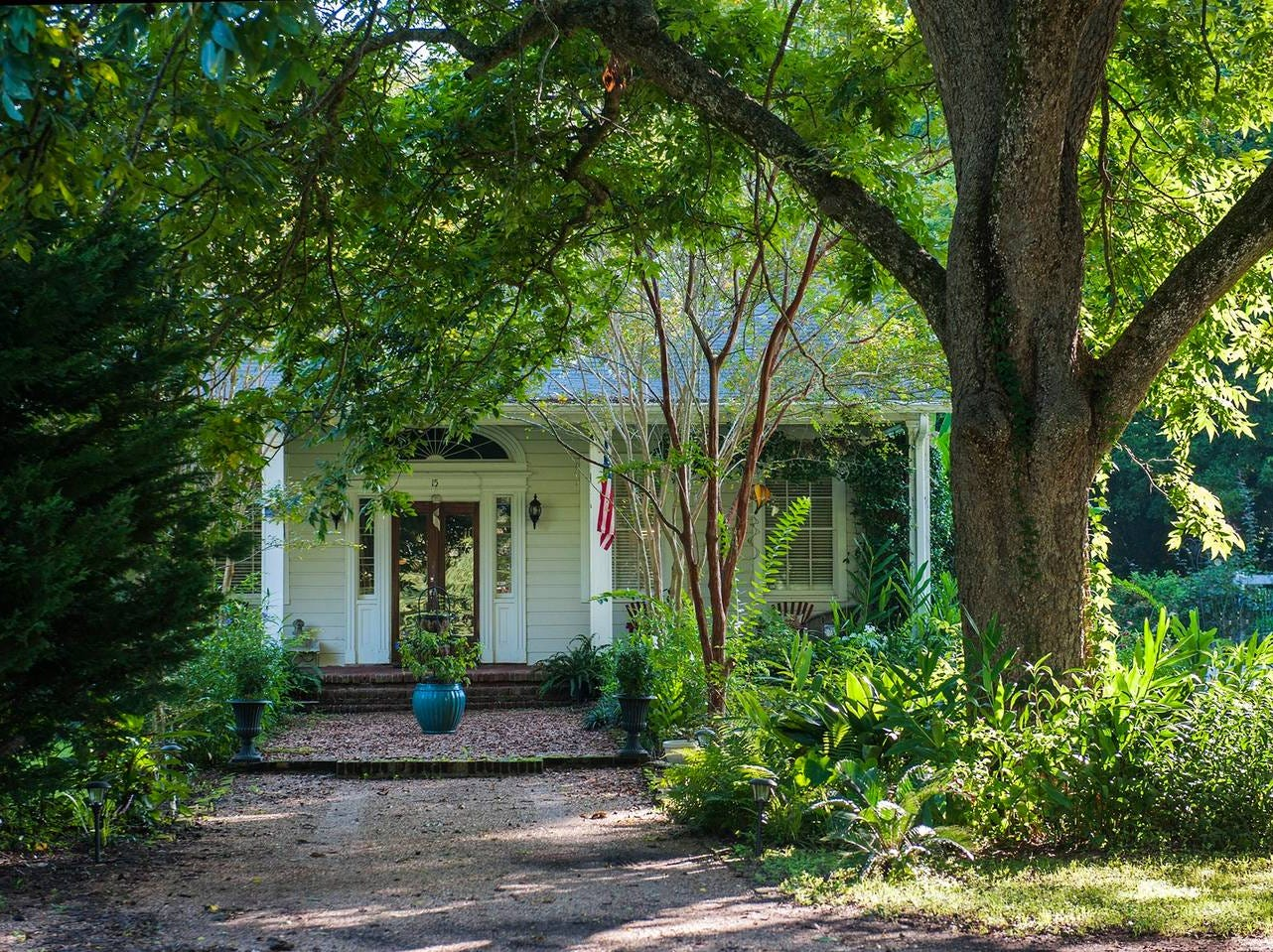 This Southern-style home, just a short walk to downtown Natchez  on the trail along the Bluff. Experience spacious living in a park-like setting.
