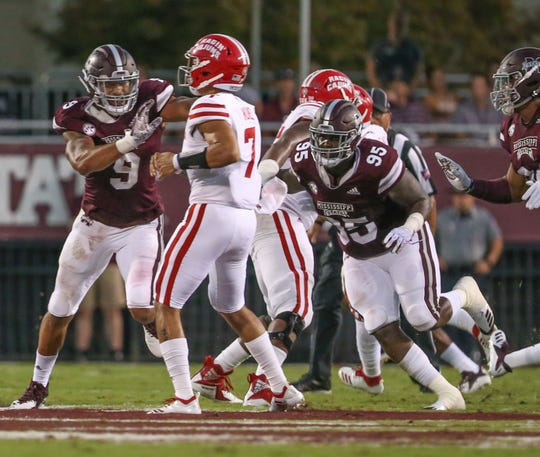 Mississippi State's Braxton Hoyett (95) and Mississippi State's Montez Sweat (9) pressure Louisiana's Andre Nunez (7). Mississippi State and Louisiana played in a college football game on Saturday, September 15, 2018, in Starkville. Photo by Keith Warren/Madatory Photo Credit