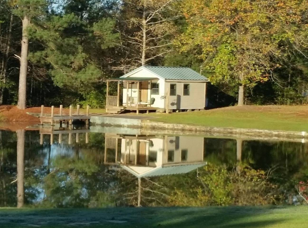 The Cozy Lil Pond House for pondering  n Daleville near Meridian has an open floor plan inside and a front porch outside to enjoy the sites on the pond.