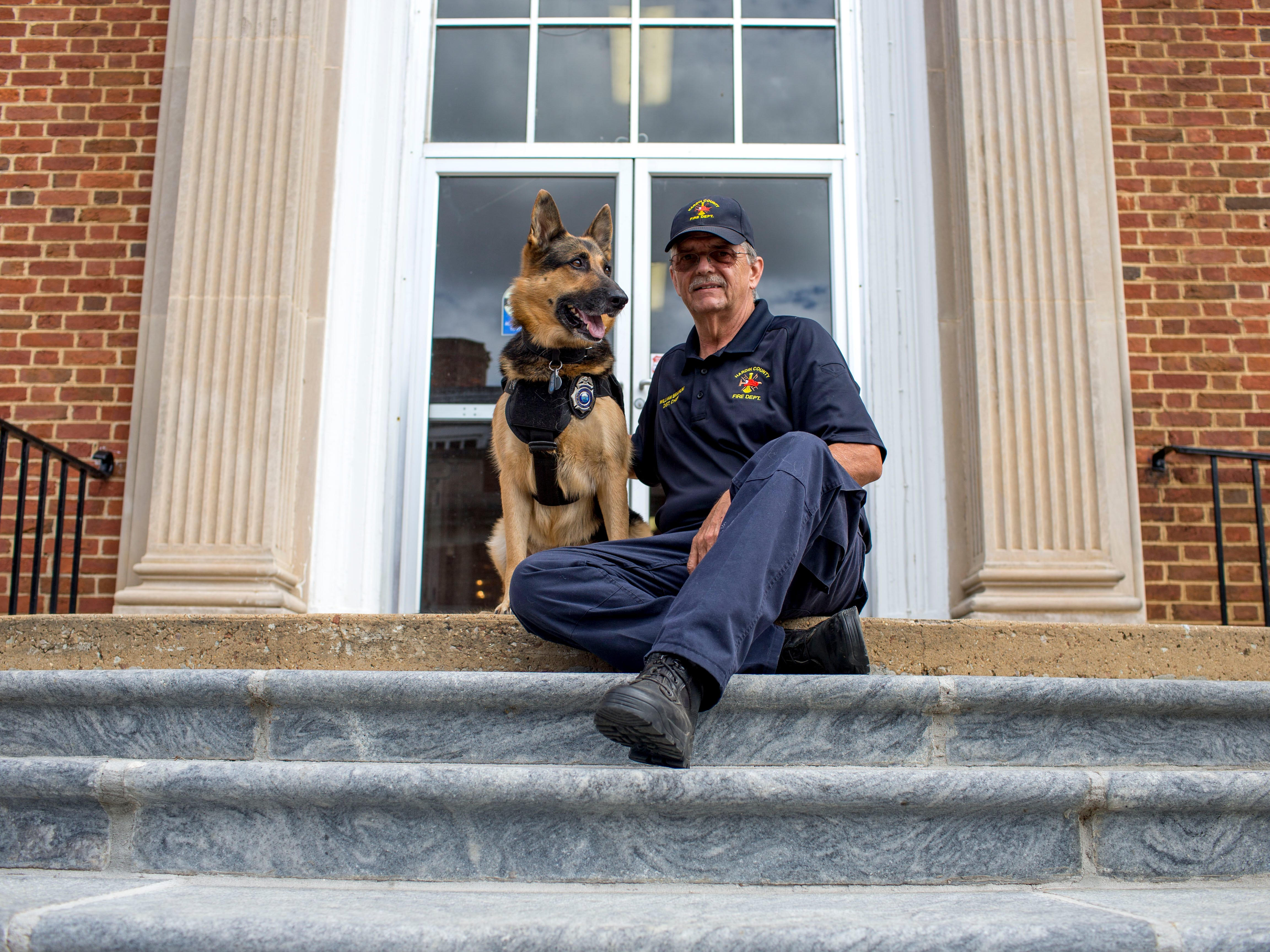 William Branum, the Hardin County fire district 14 chief, right, sits with his partner Jodi-Le at the steps outside Hardin County Circuit Court in Savannah, Tenn., on Monday, Sept. 17, 2018.