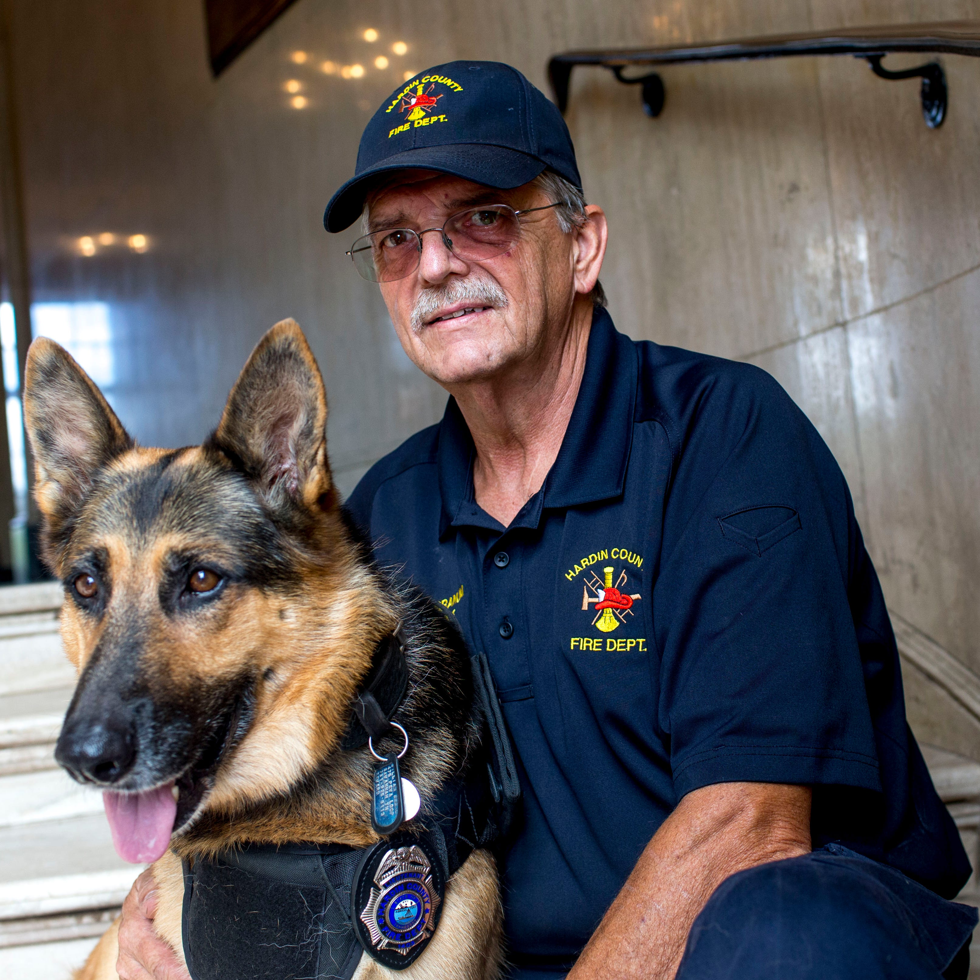 Firefighter and search and rescue dog help fight cancer