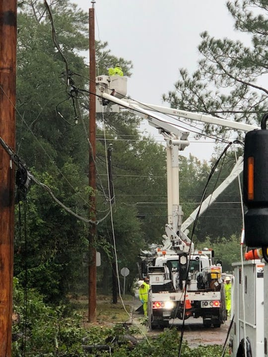 Crews from JEA help reconnect power lines in North Carolina after they were blown down by Hurricane Florence.