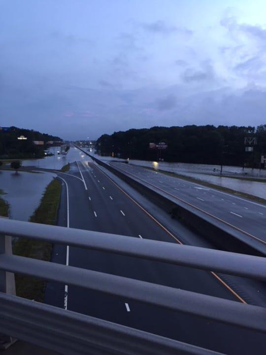 Water flows over a highway in Lumberton, N.C.