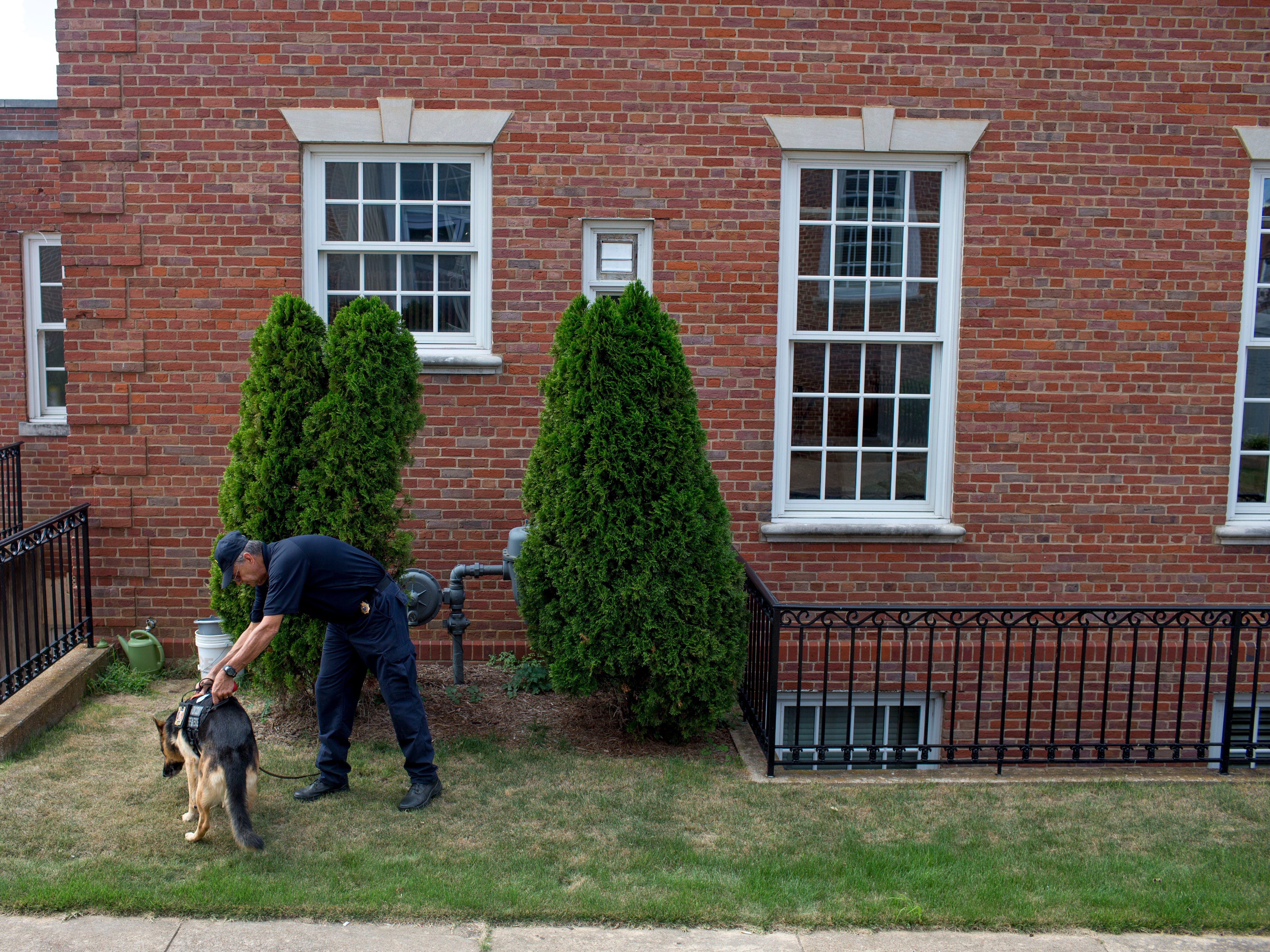 William Branum, the Hardin County fire district 14 chief, steps outside with his partner Jodi-Le at Hardin County Circuit Court in Savannah, Tenn., on Monday, Sept. 17, 2018.