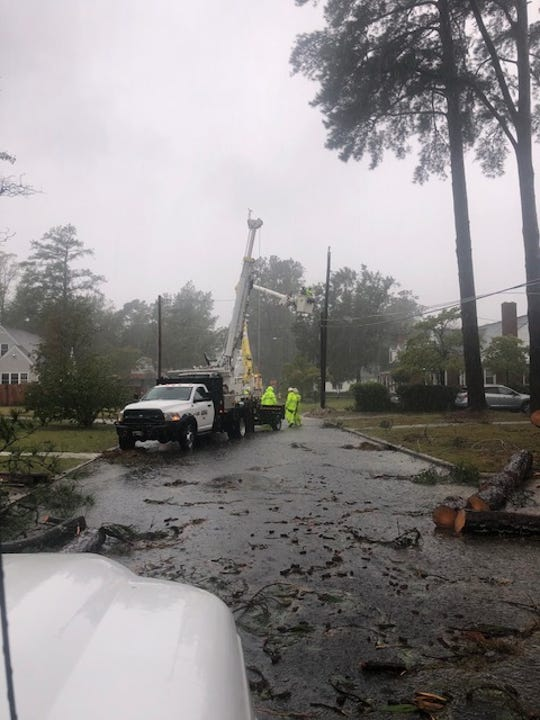 Crews from Jackson Energy Authority help in the cleanup after Hurricane Florence on Saturday.