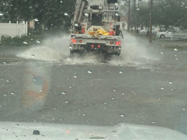 A JEA truck splashes through floodwater this past weekend in North Carolina.
