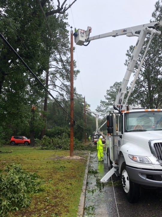 JEA crews finish installing a new power pole after Hurricane Florence passed through North Carolina last week.