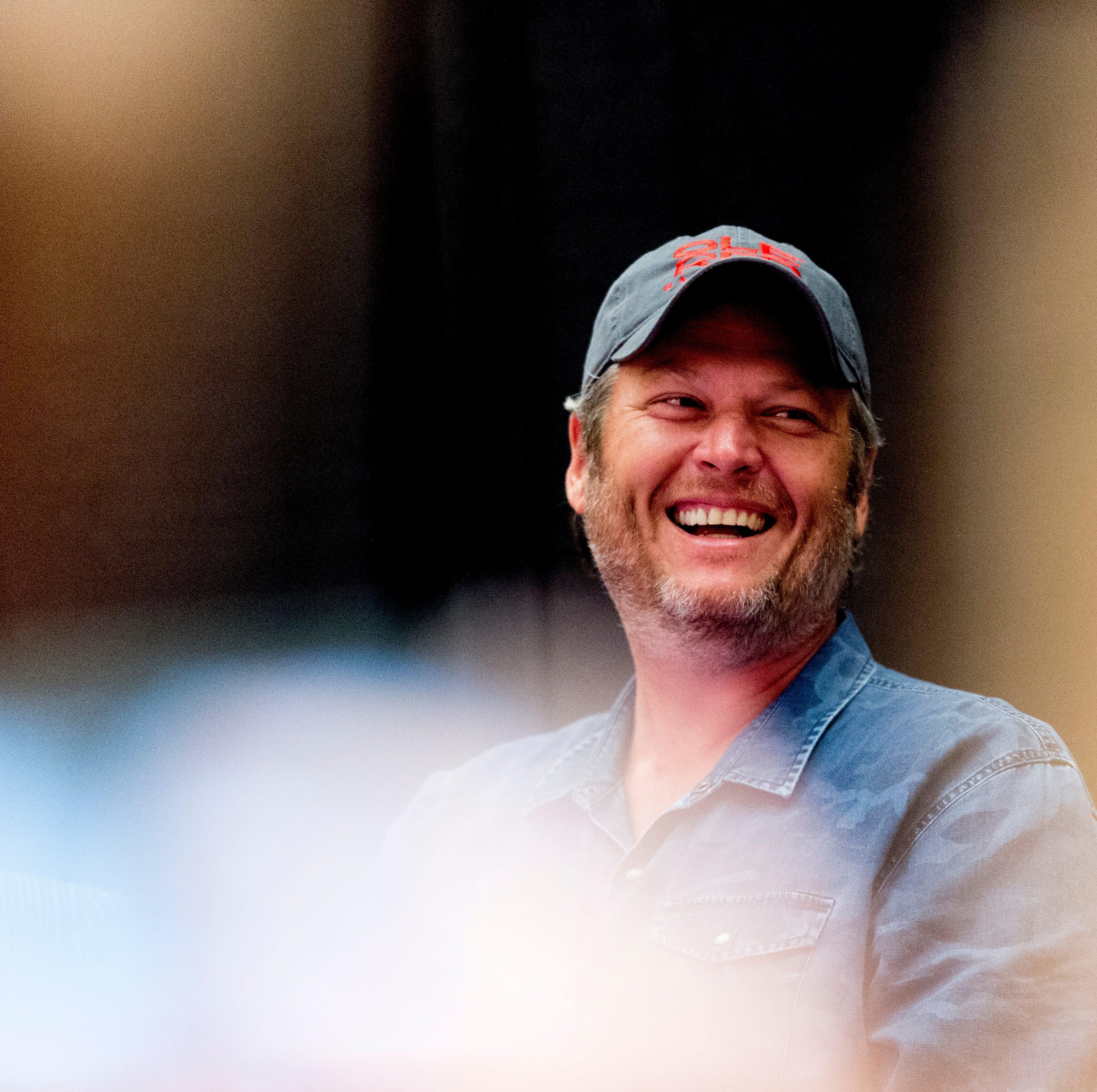 Country singer Blake Shelton laughs during an...