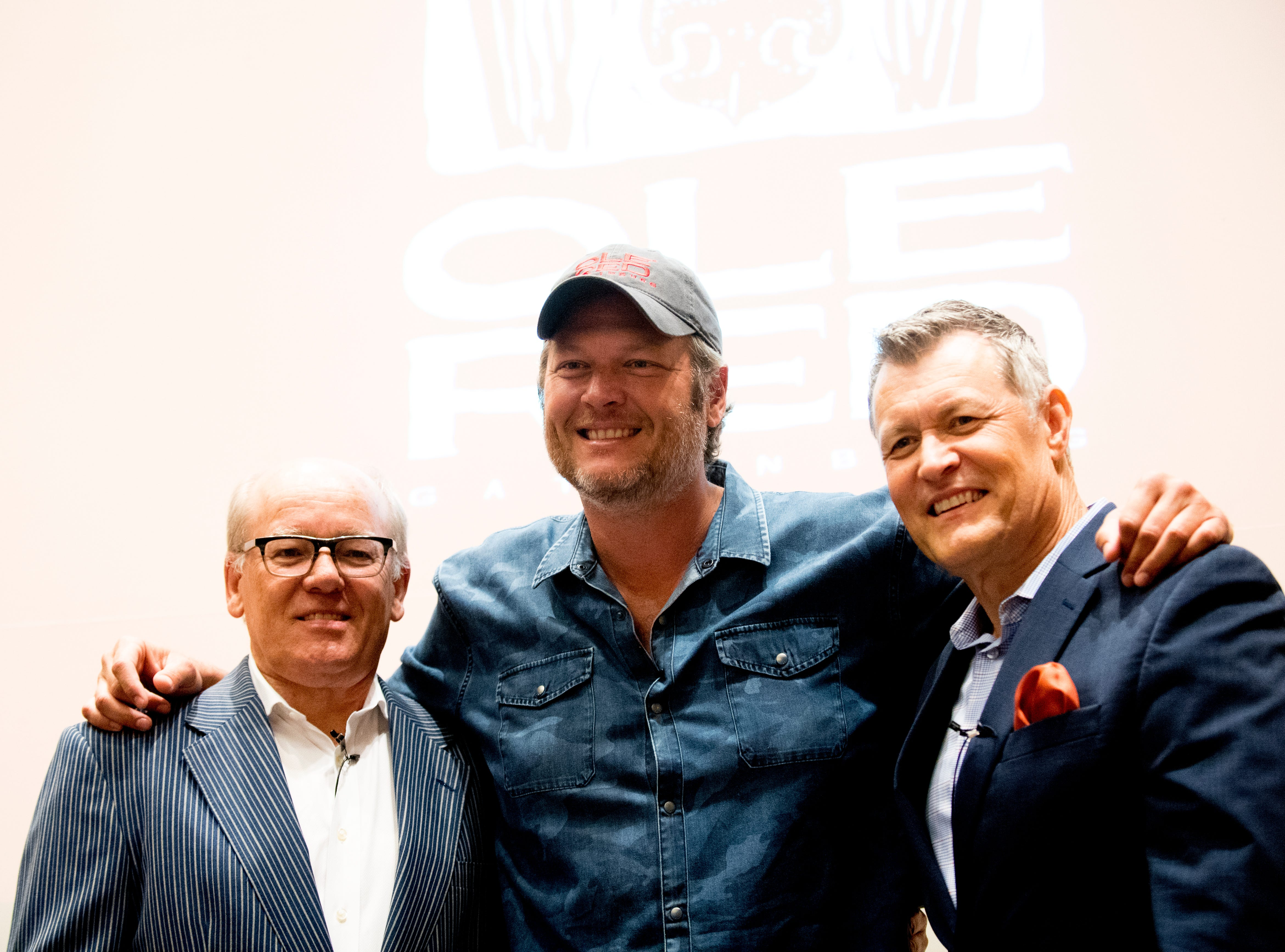 From left, Collin Reed, CEO of Ryman Hospitality, Country singer Blake Shelton and radio host Bill Cody take a photo on stage during an announcement ceremony for Ole Red Gatlinburg in Gatlinburg, Tennessee on Tuesday, September 18, 2018. Shelton has partnered with Ryman Hospitality to bring Ole Red to Gatlinburg. The 13,500 square-foot entertainment venue with a two-story bar, restaurant and performance space with space for 325 patrons is slated to open spring 2019.