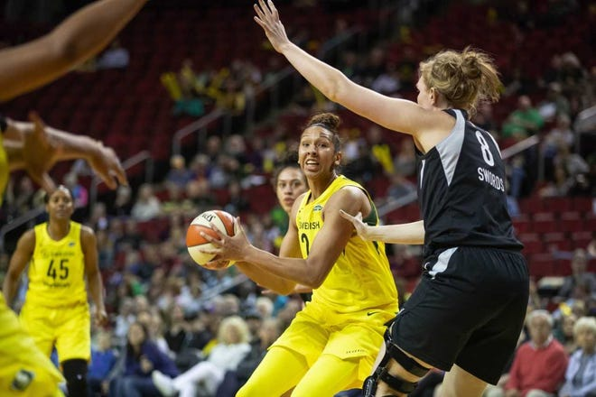 Mercedes Russell of the Seattle Storm moves to the basket as Carolyn Swords of the Las Vegas Aces defends during a game earlier this season in Seattle.