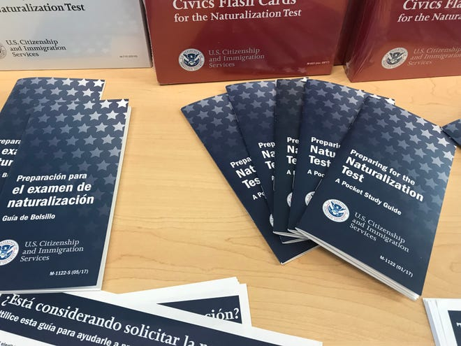 Naturalization literature is laid out on a table at at citizenship prep meeting in Knoxville on Tuesday.
