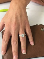 Nikki Smith shows off her wedding ring after learning she won a free wedding from Tailgate Tennessee.