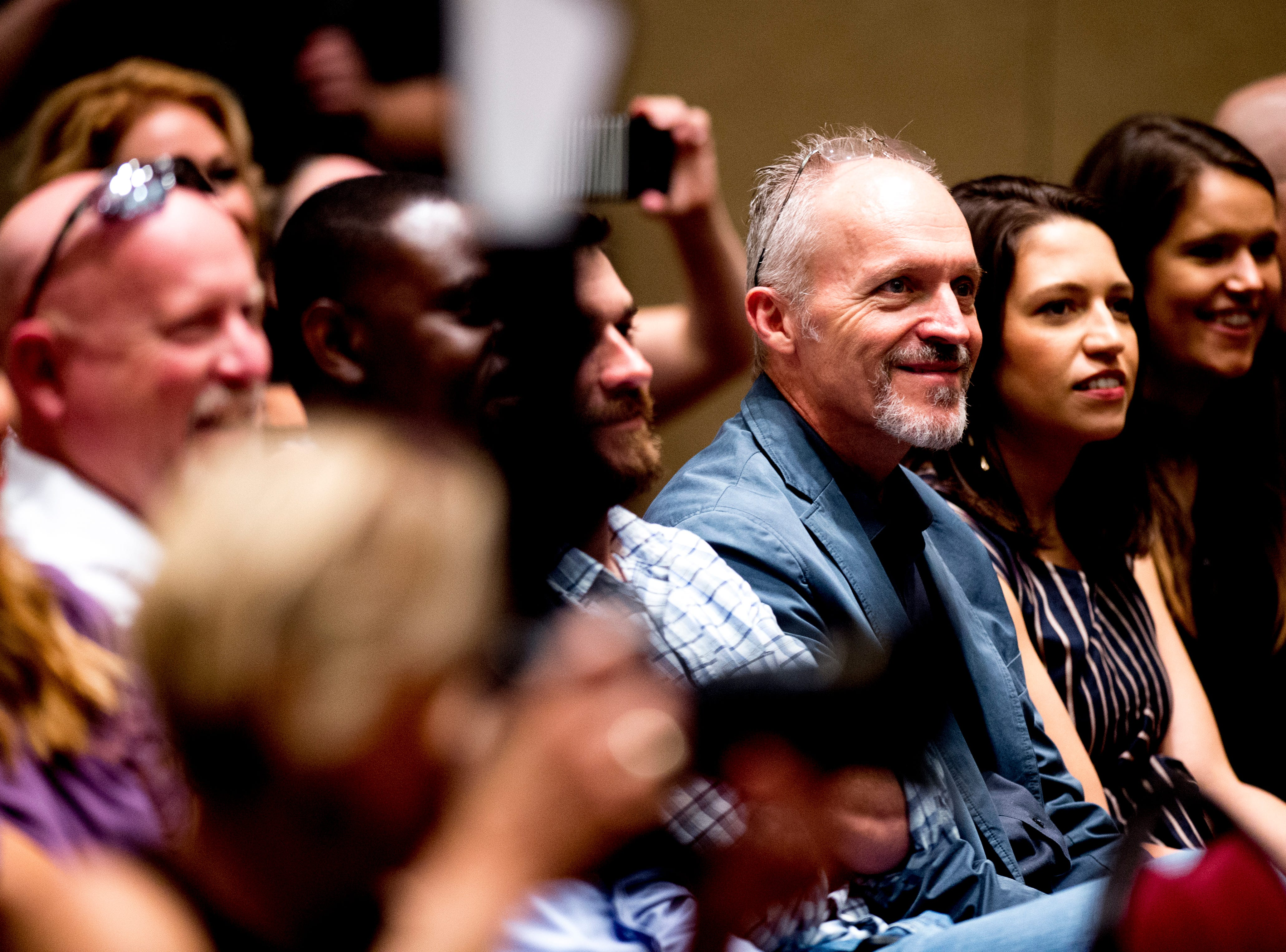 Attendees listen during an announcement ceremony for Ole Red Gatlinburg in Gatlinburg, Tennessee on Tuesday, September 18, 2018. The 13,500 square-foot entertainment venue with a two-story bar, restaurant and performance space with space for 325 patrons is slated to open spring 2019.