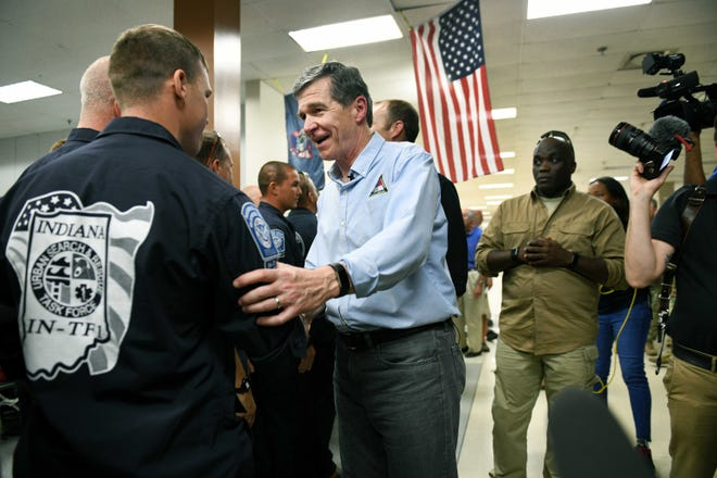 NC Gov Roy Cooper greets first responders from Indiana  staying at the FEMA Camp in Wilmington following Hurricane Florence Tuesday, September 18, 2018.