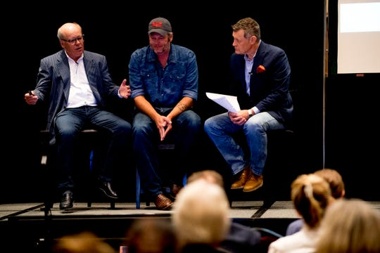 From left, Collin Reed, CEO of Ryman Hospitality, country singer Blake Shelton and radio host Bill Cody speak on stage during an announcement ceremony for Ole Red Gatlinburg in Gatlinburg, Tennessee on Tuesday, September 18, 2018. Shelton has partnered with Ryman Hospitality to bring Ole Red to Gatlinburg. The 13,500-square-foot entertainment venue with a two-story bar, restaurant and performance space with space for 325 patrons is slated to open spring 2019.