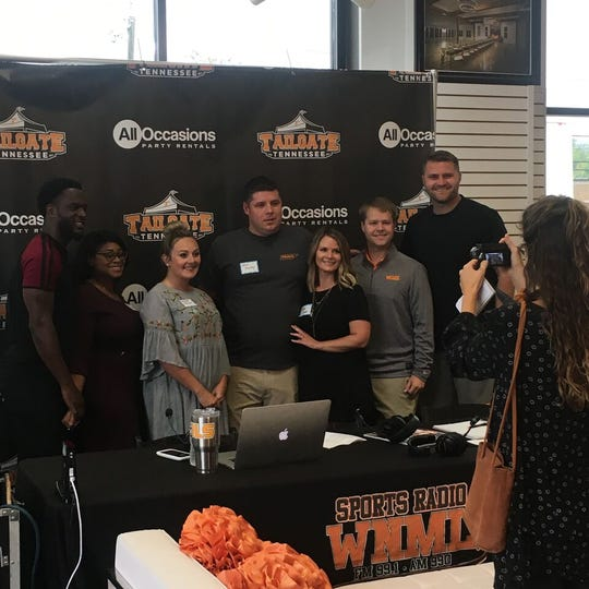 The finalists of Tailgate Tennessee's wedding giveaway stand with Erik Ainge for a picture.