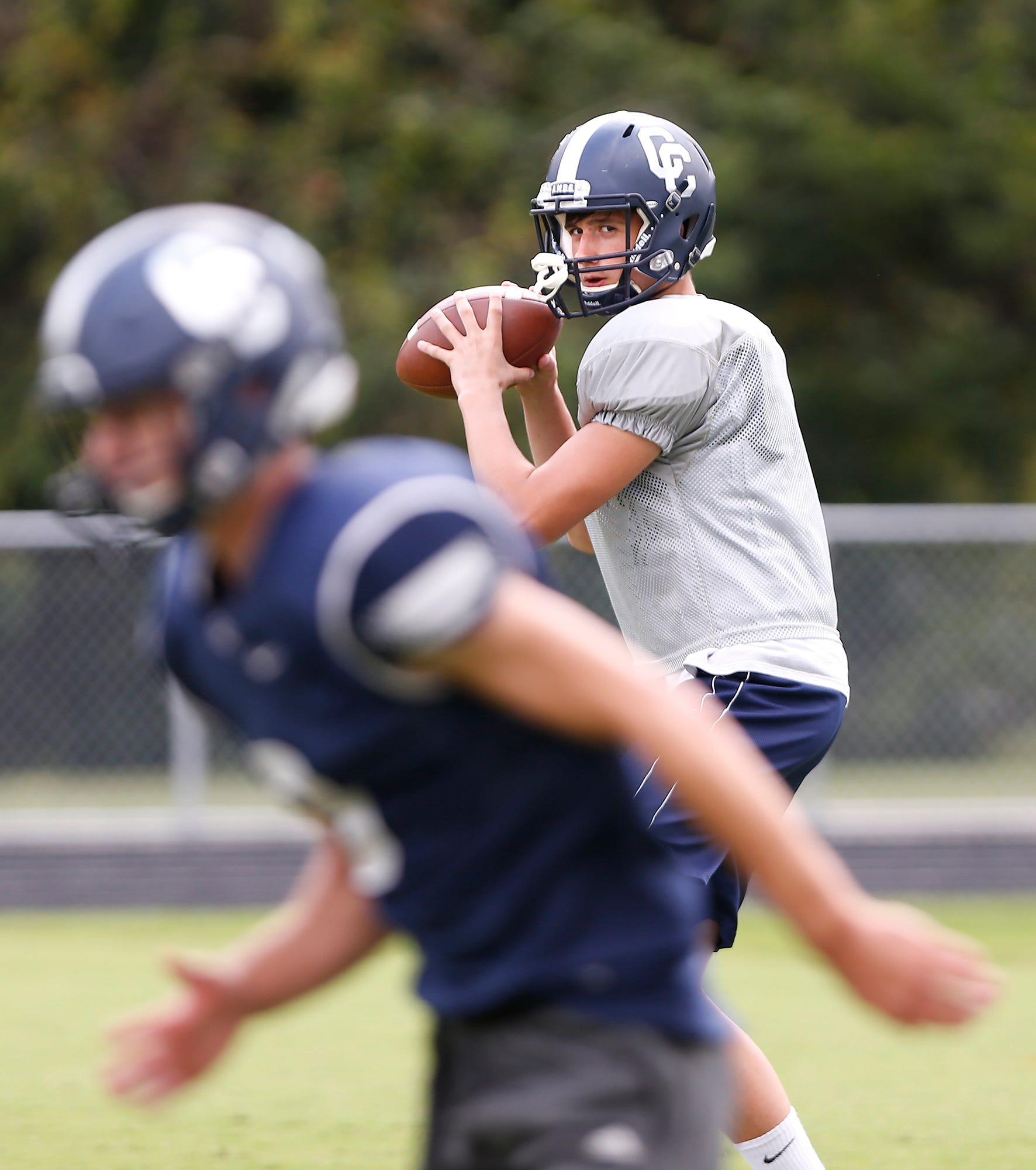 Clark Barrett gets set for a pass during football practice Tuesday at Central Catholic.