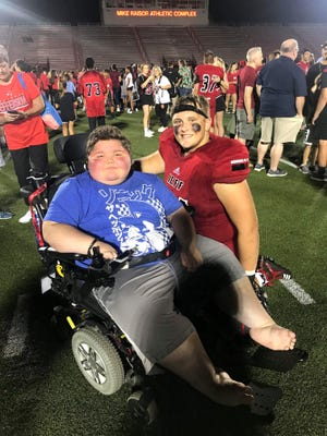 Lafayette Jeff junior Cody Payne suffers from muscular dystrophy. Last Friday, offensive guard Drew DeBoer, right, got Payne a sideline pass so he could watch the Bronchos defeat Kokomo on Homecoming. (Photo courtesy of Kim DeBoer)