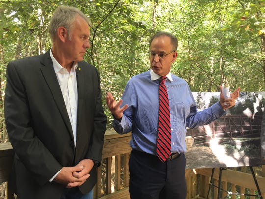 Louisiana native Scott Angelle, right, director of the Bureau of Safety and Environmental Enforcement in Washington, D.C., speaks with U.S. Interior Secretary Ryan Zinke at the Acadiana Nature Station in Lafayette Sept. 18, 2018.