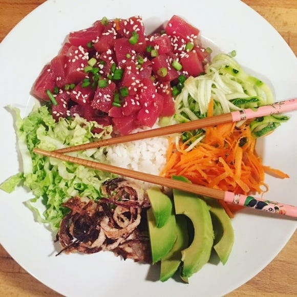 Poke bowls typically feature raw fish, veggies, sauce and other toppings over a bed of rice.
