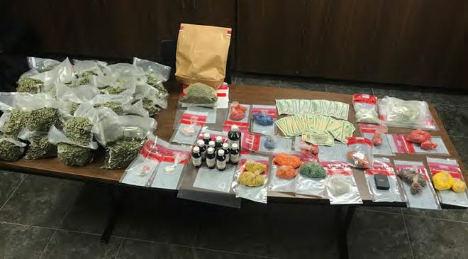 Two people are facing multiple drug possession charges after police seized a quantity of narcotics worth almost $1 million in Scott.