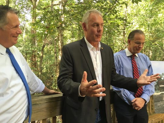 U.S. Interior Secretary Ryan Zinke, center, announces a grant Sept. 18, 2018, for Lafayette's Acadiana Nature Station. Mayor-President Joel Robideaux is picture on the left. Scott Angelle, director of the Bureau of Safety and Environmental Enforcement is on the right.