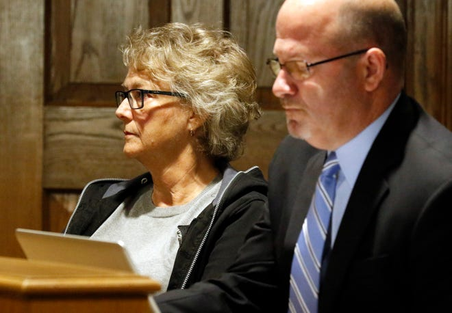 Lynn Kraner, Walnut Township fiscal officer, sits next to her attorney Scott Wood, right, Tuesday morning, Sept. 18, 2018, in Fairfield County Common Pleas Court in Lancaster. Kraner pleaded guilty to one misdemeanor count of having an unlawful interest in a public contract. Kraner was sentenced to community control, fined $200 and ordered to pay $1,915 in restitution to the township because she did not let trustees know a woman they hired was her sister.