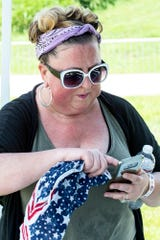 Rock concierge Alene Day spends much of her time on the phone as she manages several moving parts during large scale events and festivals. 7/4/18