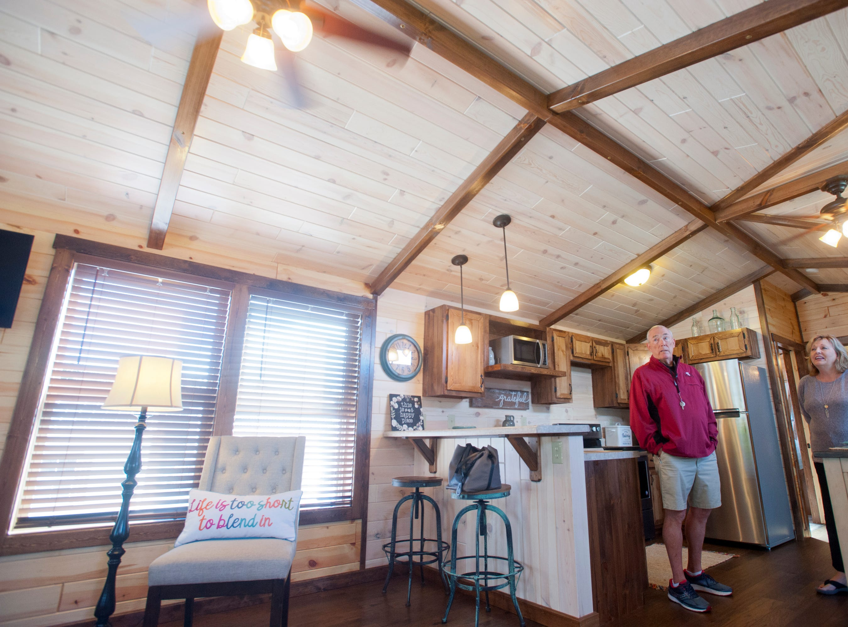 "Amish Made Cabins of Shepherdsville is making this ""White River"" cottage, geared toward its elderly and disabled customers. Here, co-owners Jim and Pamela White stand in the home's open-concept kitchen. The front living room is at left.