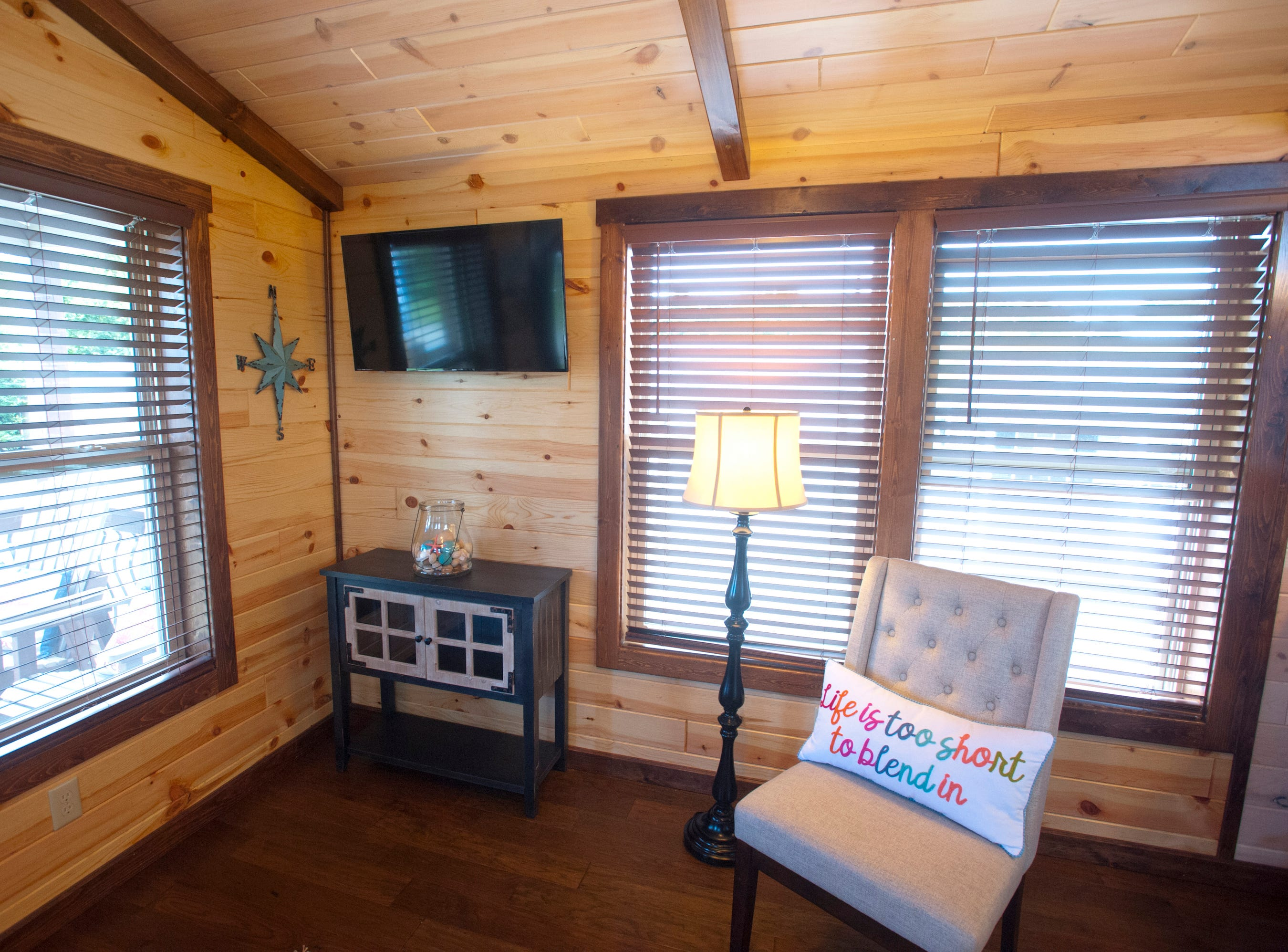 """Amish Made Cabins of Shepherdsville is making this """"White River"""" cottage, geared toward its elderly and disabled customers. Here is the living room in the front of the house.September 10, 2018"""