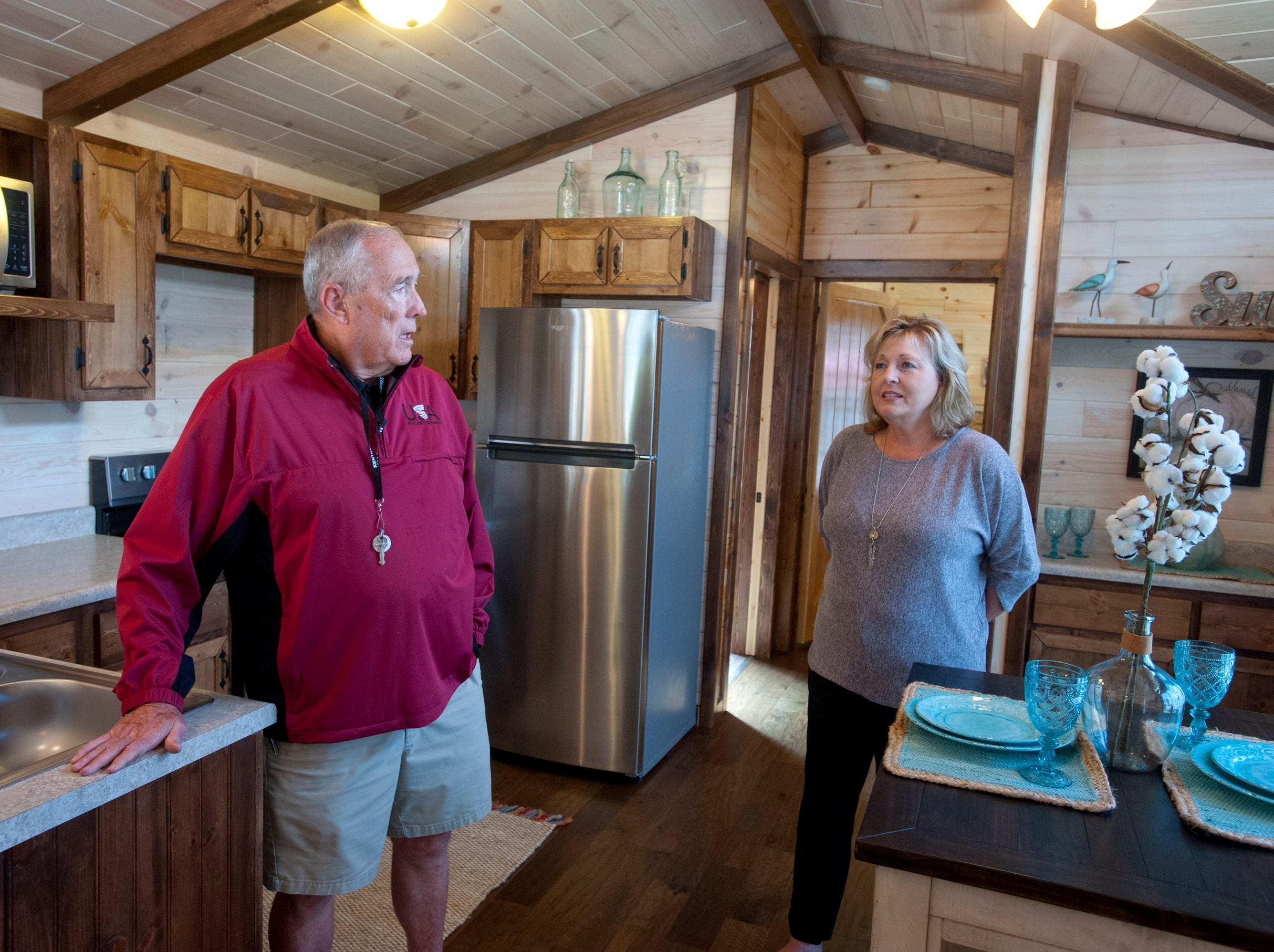 """Amish Made Cabins of Shepherdsville is making this """"White River"""" cottage, geared toward its elderly and disabled customers. Here, co-owners Jim and Pamela White chat in the home's open-concept kitchen.September 10, 2018"""