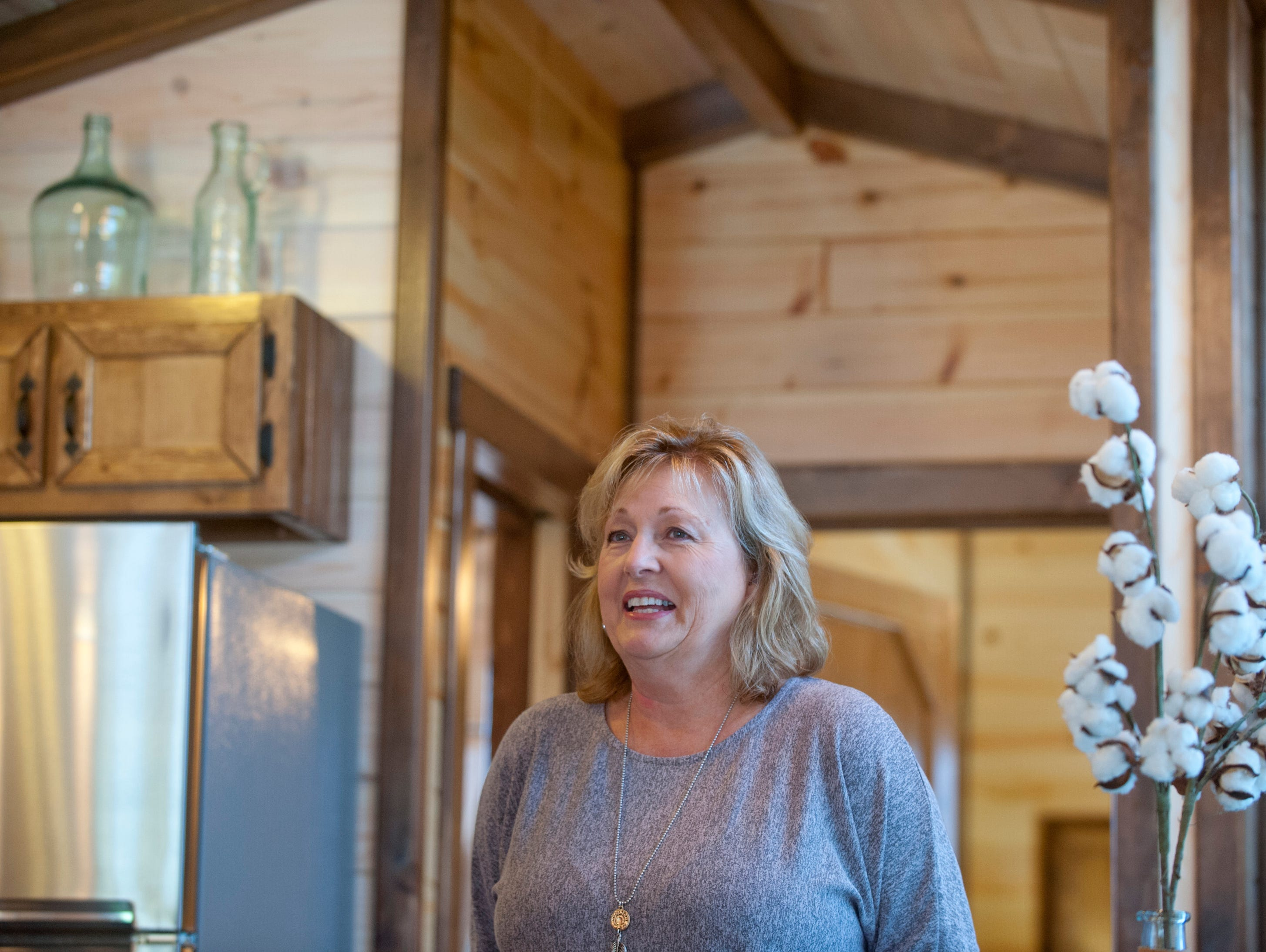 Co-owner Pamela White stands in the kitchen of the home.September 10, 2018