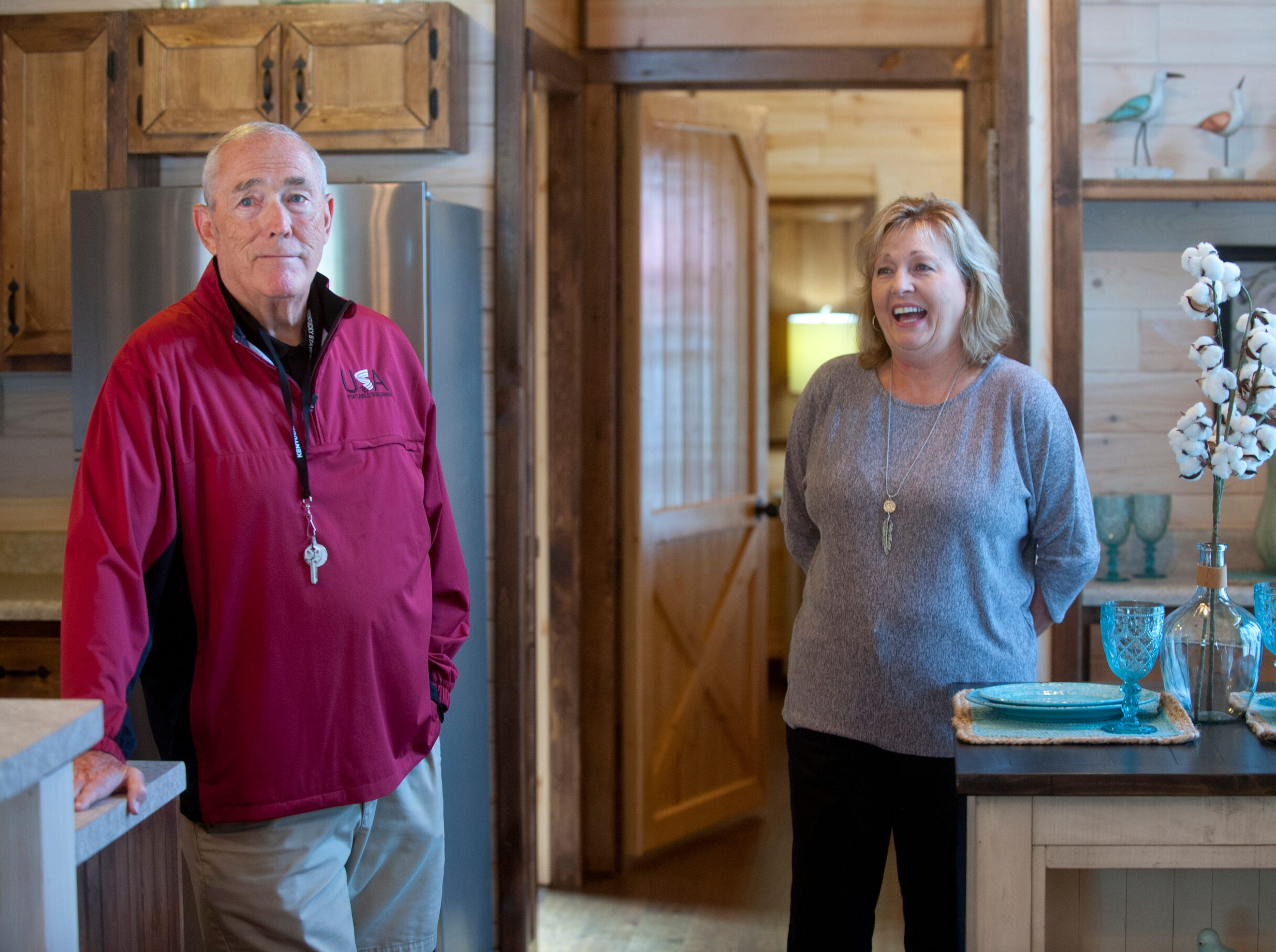 "Amish Made Cabins of Shepherdsville is making this ""White River"" cottage, geared toward its elderly and disabled customers. Here, co-owners Jim and Pamela White stand in the home's open-concept kitchen. 