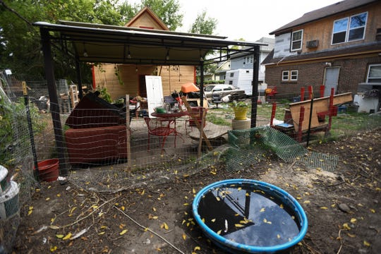 The backyard of a home on west Michigan Avenue, pictured Tuesday, Sept. 18, 2018, after authorities seized marijuana plants, ducks, chickens, and pit bull puppies according to a resident.