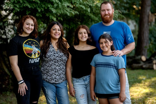 """Cindy Shank, second from left, poses with her daughters, from left, Autumn, Ava, Annalis and their father and Cindy's ex-husband Adam Shank on Monday, Sept. 17, 2018, in DeWitt. """"The Sentence,"""" directed by former Lansing resident Rudy Valdez, chronicles the decade-long aftermath of Cindy's conviction on federal drug charges."""