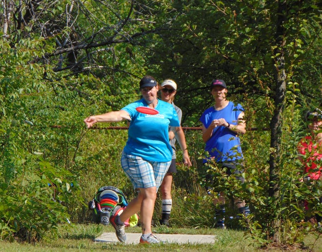 Erin Oakley of DeWitt, throws the disc during a disc golf competition. Oakley will be one of 10 women in the Lansing area competing in the 2018 Professional Disc Golf Association Women's Disc Golf championships Sept. 20-23 at Burchfield Park in Holt.