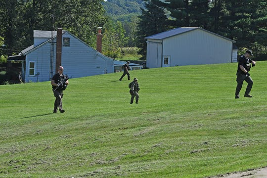 Law enforcement officers fan out Tuesday afternoon as they continued to search for Shawn Christy around the Orchard Park Road area.