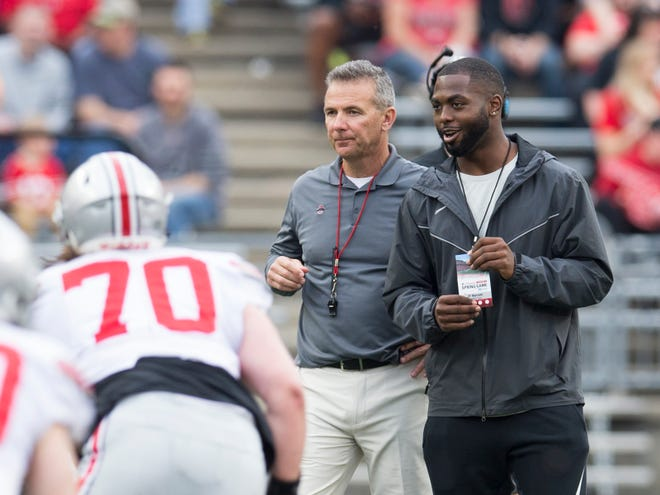 Urban Meyer, shown here at this year's spring game with former quarterback J.T. Barrett has finished his three-game suspension and will coach Ohio State in Saturday's home game with Tulsa.