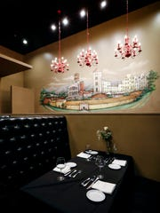 A hand-painted mural of the Italian city Lucca overlooks the main dining room in chef Judd Grisanti's new Ronnie Grisanti's Italian Restaurant in the Regalia Shopping Center.