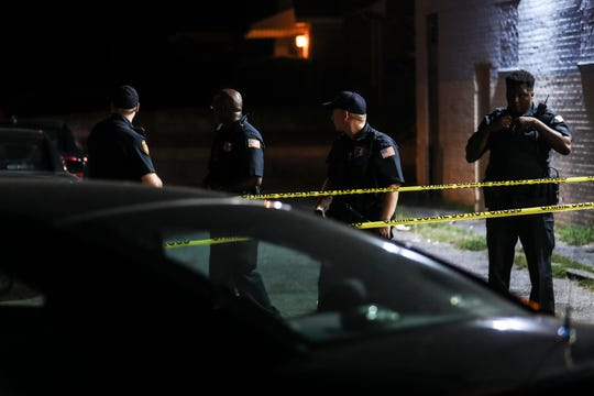 Officers stand at the scene where a driver was shot and critically injured by a Memphis police officer Monday evening in South Memphis.